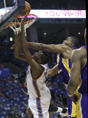 Oklahoma City Thunder forward Kevin Durant, left, is fouled by Los Angeles Lakers center Andrew Bynum, right, in the third quarter of Game 3 of a first-round NBA basketball playoff series