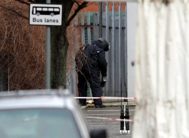 Bomb disposal expert, prepares to examine an object, in an alleyway close to Xtravision, on the Antrim road not far from a police station in north Belfast during a bomb alert.