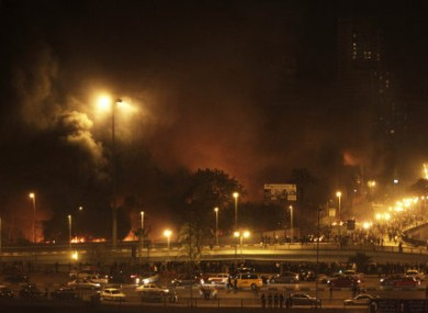 Fires from burning buildings are seen at night on the Corniche, an area of the city taken over by anti-government protesters, in downtown Cairo, Egypt. this evening.