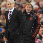 Fulham manager Mark Hughes and Liverpool manager Kenny Dalglish share a joke after sparky juggled a football. <span class=