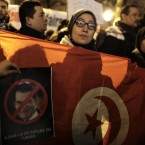 Demonstrators stage a protest to calling for the resignation of Tunisian President Zine El Abidine Ben Ali, featured on posters here.