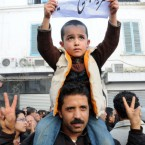 A child holds a sign asking for the release of Tunisians, kept in custody by police following recent protests, during a demonstration held in Tunis last Saturday.