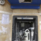 A bank ATM is vandalised during clashes between protestors and police in Ettadhamoun, west of Tunis today.