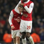 Arsenal's Johan Djourou and Jack Wilshere celebrate victory over Ipswich Tow in the Carling Cup semi-final in midweek. 
