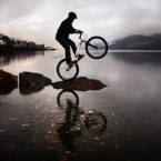 British Trials Champion Gary MacDonald is pictured reflected in Loch Linnhe near Fort William in Scotland, during the launch of the tenth Fort William Mountain Festival.<span class=