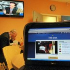 A laptop in the TV3 canteen shows a Fine Gael live web link to a public meeting in Carrick-on-Shannon where Enda Kenny was speaking instead of attending the first leaders' debate. Pic: PA Images/Julien Behal.