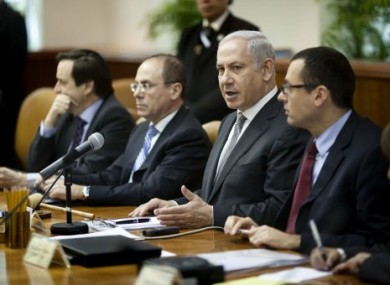 Israeli Prime Minister Benjamin Netanyahu, second right, convenes the weekly cabinet meeting in Jerusalem, Sunday, March 6, 2011.