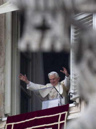 Pope Benedict XVI delivers his blessing during the Angelus noon prayer celebrated from the window of his studio overlooking St. Peter's square at the Vatican, Sunday, March 13, 2011.