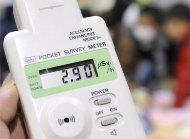A pocket radiation detector shows 2.9 micro-sieverts per hour at an evacuation center in Koriyama for people living around the Fukushima Dai-ichi nuclear plant Tuesday afternoon, March 15, in Fukushima Prefecture.