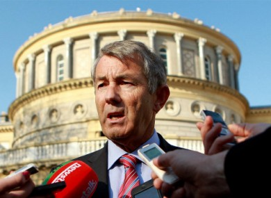 Independent TD Michael Lowry speaks to the media on the plinth of Leinster House in Dublin.
