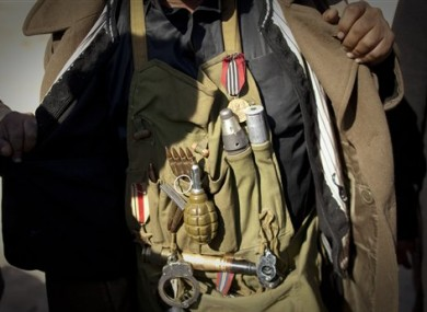 A Libyan rebel displays his ammunition before moving closer to the frontline after Moammar Gadhafi's forces fired on them on the frontline of the outskirts of the city of Ajdabiya, south of Benghazi, eastern Libya, Tuesday, March 22, 2011.