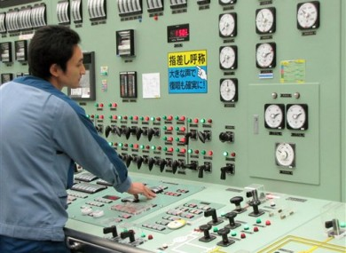 In this Sept. 2010 photo, an operator works at Unit 3 reactor of the Fukushima Daiichi Nuclear Power Plant in Okumamachi, Fukushima Prefecture.