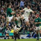 England's Tom Wood, right, challenges Ireland's Donncha O'Callaghan for the ball in the air.