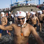 Trainee lifeguards from El Salvador's Red Cross take part in the event in La Libertad which requires them to swim 21km in the ocean to graduate. Pic: AP Photo/Edgar Romero.