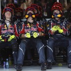 Reb Bull technicians squeeze in to watch the action at the Grand Prix in Melbourne.