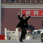 A police man on a segway questions a delegate of the National People's Congress who was performing exercises on Tiananmen Square outside the Great Hall of the People in Beijing, China. (AP Photo/Ng Han Guan)