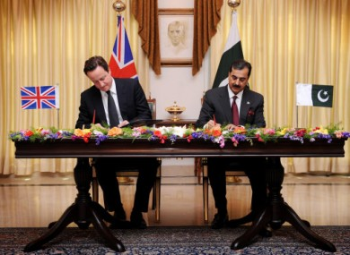 Prime Minister David Cameron signs an Enhanced Strategic Dialogue document between the UK and Pakistan with Pakistan Prime Minister Yusuf Raza Gilani.
