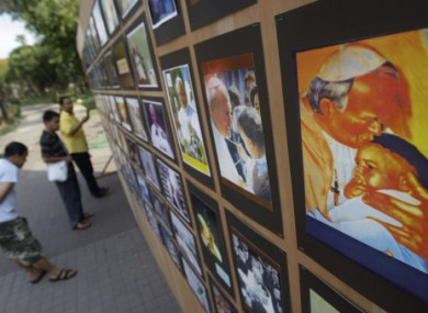 Filipinos look at a photo exhibit showing the late Pope John Paul II's visits to the country on April 27, 2011. The beatification of the late Pope John Paul II is to take place on Sunday 1 May.
