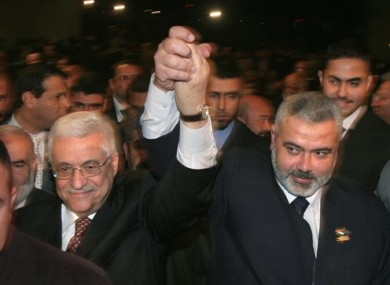 Palestinian Authority President Mahmoud Abbas, left, and Prime Minister Ismail Haniyeh from Hamas