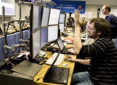 File photo shows a scientist in one of CERN's control rooms.