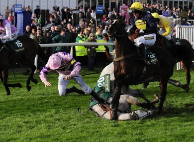 Ruby Walsh takes a tumble from Sire Collonges at the final hurdle in the Silver Cross Hurdle Race at Aintree today.