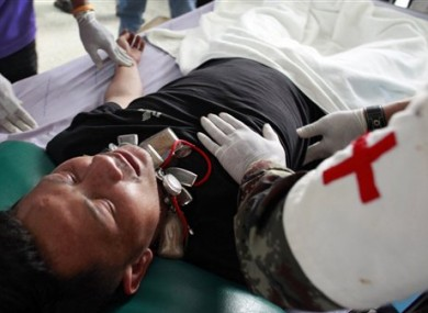 Medical personnel examine an injured Thai soldier at a hospital following clashes between Thai and Cambodia in Surin province, northeastern Thailand, Thursday, April 28, 2011.