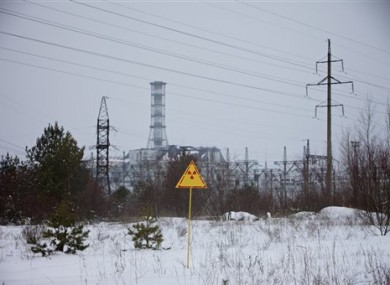 A radiation attention sign is seen in front of the building of Reactor No. 4 at the Chernobyl nuclear power plant in Ukraine.