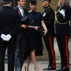 Victoria Beckham wore a Philip Treacy hat; her husband wore Ralph Lauren.