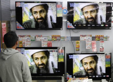 A man watches TV screens reporting on the death of Osama bin Laden, seen as the architect behind the Sept. 11, 2001, attacks against the United States, at an electronics store in Tokyo.
