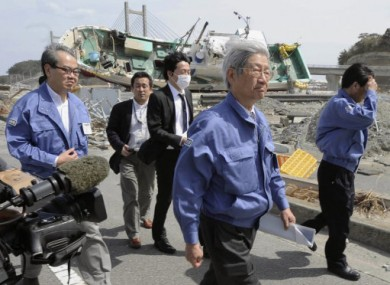 Makoto Iokibe (center R), head of the Japanese government's Reconstruction Design Council, visits Soma port in Fukushima Prefecture.