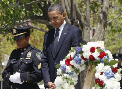 President Barack Obama pauses after laying a wreath at the National Sept. 11 Memorial at Ground Zero in New York, Thursday, May 5, 2011.
