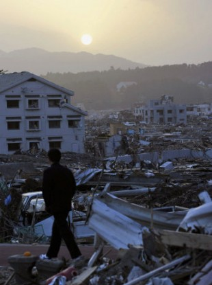 A boy walks along a road at sunset on May 13, 2011, in the town of Minamisanriku, Miyagi Prefecture, which was devastated by the March 11 earthquake and tsunami.