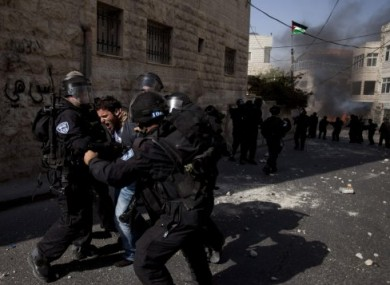 Israeli troops arrest a Palestinian protester, during a demonstration to mark the 63rd anniversary of