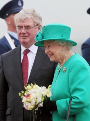Britain's Queen Elizabeth II is greeted by Tanaiste Eamon Gilmore upon arrival at Casement Aerodrome, Baldonnel, ahead of a four day state visit.