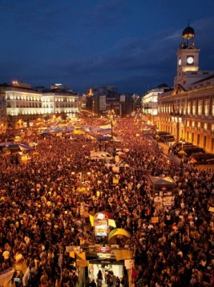 Tens of thousands of people take part in a demonstration in Madrid, Saturday, May 21, 2011.