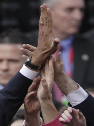 US President Barack Obama gives a high five to a well wisher after his speech at College Green, Dublin.