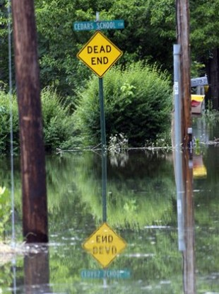 A traffic sign is reflected in the Mississippi flood waters in south Vicksburg, Mississippi.
