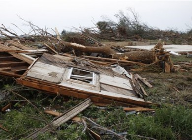 An abandoned farmhouse has been reduced to rubble following a tornado in Piedmont, Oklahoma, 24 May 2011.