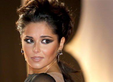 Cheryl Cole arrives for the Brit Awards 2011 at The O2 Arena in London.