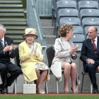 The visiting party take their seats at the edge of the pitch.