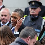 Obama speaks to the mother of a spectator by phone. (Pic: Stephen Kilkenny)