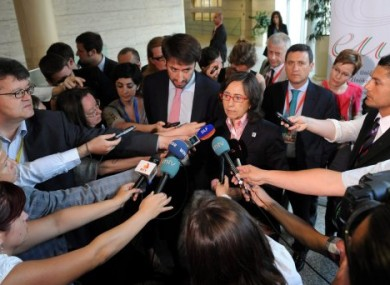 Minister of Environment, Rural and Marine Affairs of Spain, Rosa Aguilar Rivero, center, speaks to journalists.