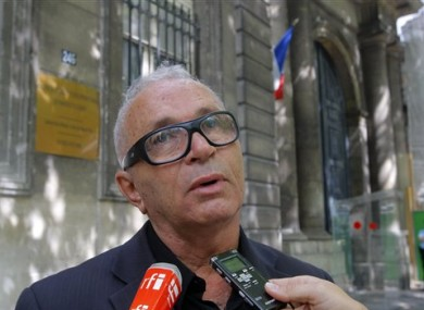 Nelson Marinho, president of Brazil's association of victims' families, answers reporters questions in Paris,Wednesday June 15, 2011.