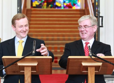 An Taoiseach Enda Kenny, with An Tainiste Eamon Gilmore arriving at government buildings in Dublin to brief the media on the first 100 days of the Fine Gael - Labour Party Government