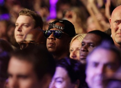 Jay-Za watches Beyonce at Glasto last night. The couple will be on centre court today.