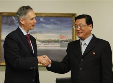 Democratic People's Republic of Korea's Kim Pyong Ho, President of Korean Central News Agency, right, shakes hands with Associated Press President and CEO Tom Curley