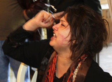 Iman al-Obeidi is seen after bursting into a hotel to show her wounds and allege to foreign journalists that she was gang raped by Muammar Gaddafi's troops.