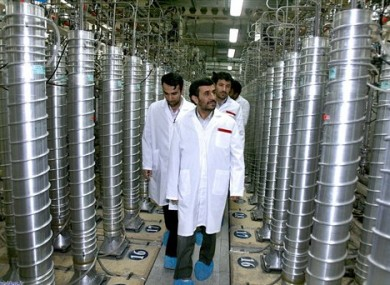 In this Tuesday, April 8, 2008 file photo released by the Iranian President's Office, Iranian President Mahmoud Ahmadinejad, center, visits the Natanz Uranium Enrichment Facility.