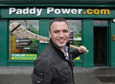 'Jobless Paddy' joins Paddy Power: Féilim Mac An Iomaire poses outside a bookies' outlet e