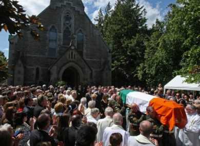 The coffin bearing the remains of Brian Lenihan is carried away from St Mochta's Church in Porterstown, Dublin this morning following his funeral Mass